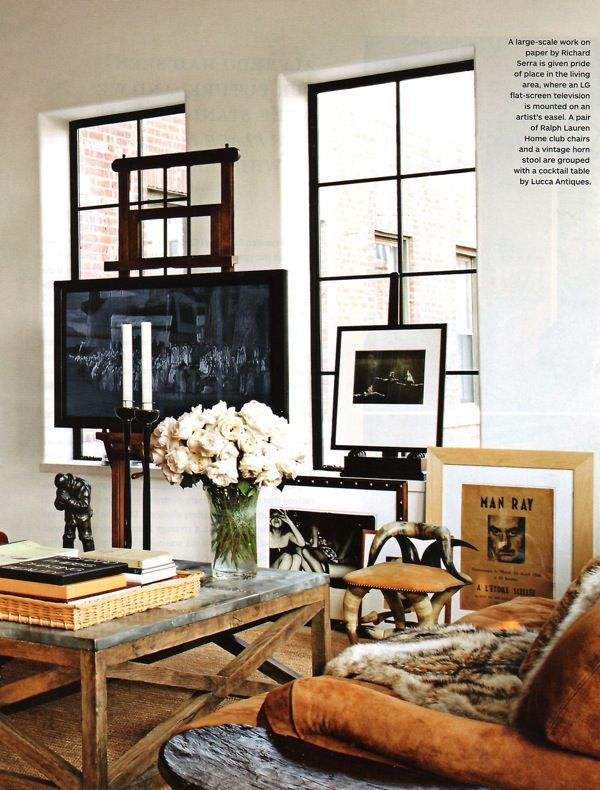 Modern rustic neutral with TV on artists easel, cool touch.