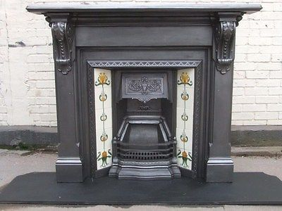 Original Edwardian cast iron fireplace with surrounds and tiles.