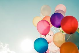 picture of happy birthday - Colorful balloons flying on sky with a retro vintage filter effect - JPG