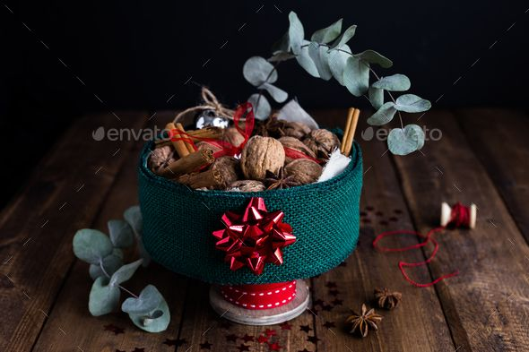 Horizontal View of Christmas Tin filled with Nuts and Spices on Rustic Table - Stock Photo - Images Download here : https://photodune.net/item/horizontal-view-of-christmas-tin-filled-with-nuts-and-spices-on-rustic-table/18917332?s_rank=7&ref=Al-fatih