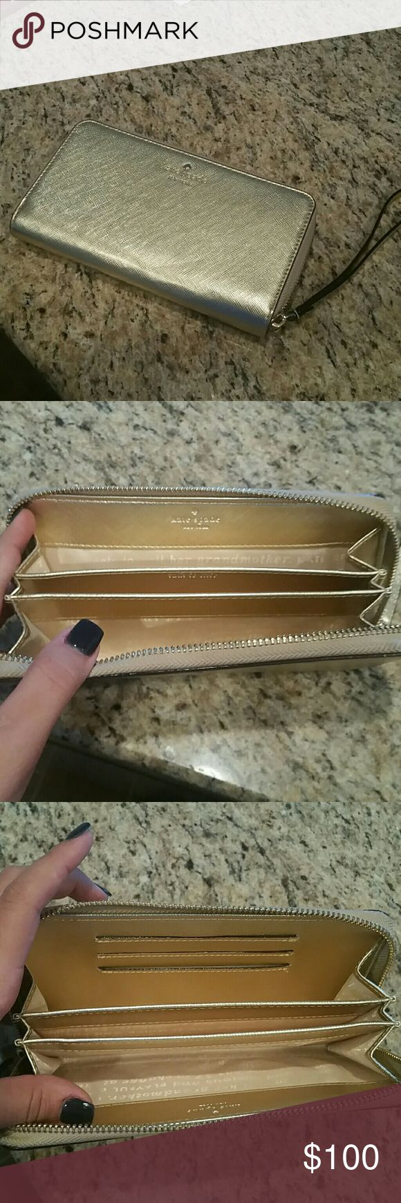 New Kate Spade Gold Wristlet New with tags Kate Spade gold wristlet . It can fit iPhone 7 size phone or Galaxy Note size phone.  two separate compartments for extra items. It  also has the three card holders to hold debit card driver's license or credit cards and excellent condition used only once kate spade Other