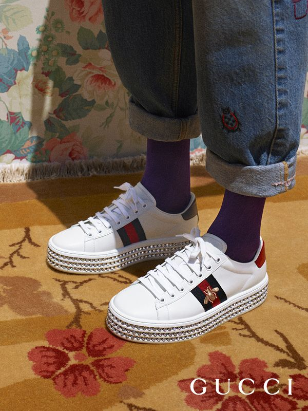 Embellished with rows of crystals trimmed along a platform sole, the new  Gucci Ace sneaker from Cruise 2018 by Alessandro Michele. 87224df52149