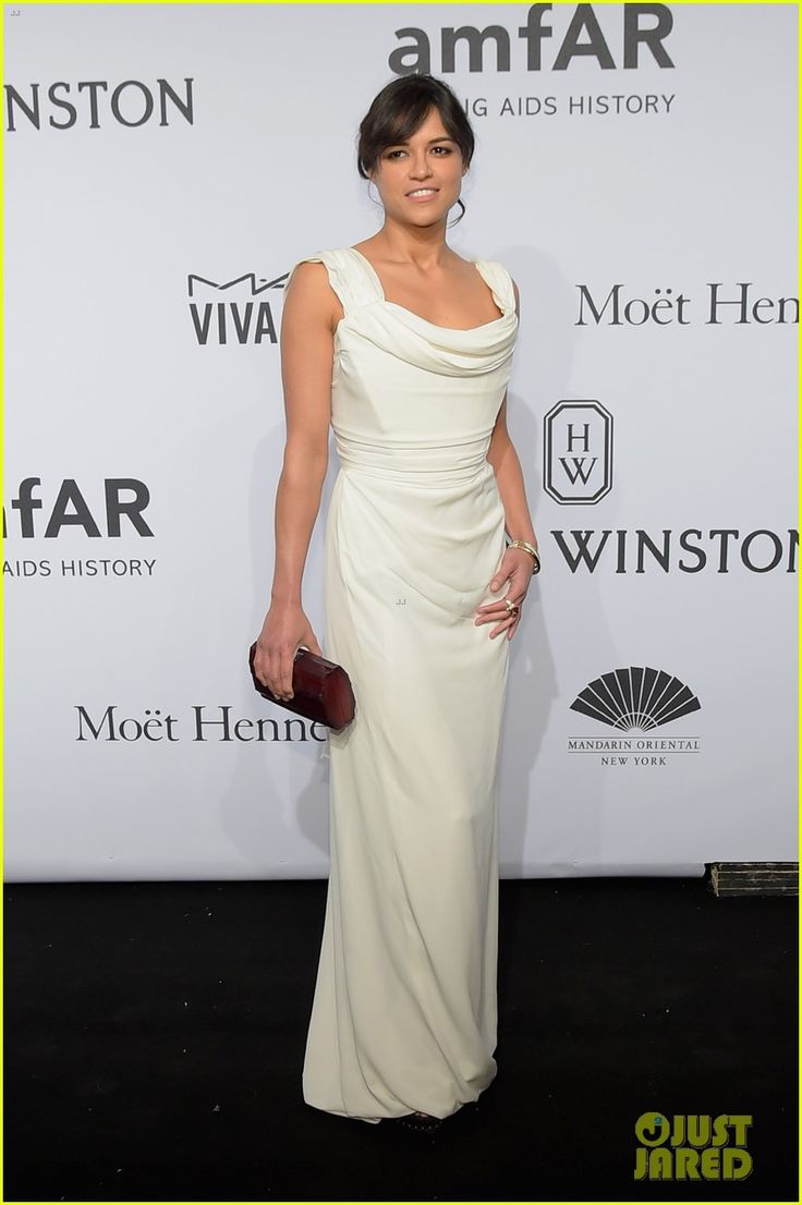 Michelle Rodriguez in a Vivienne Westwood dress and Kara Ross clutch.