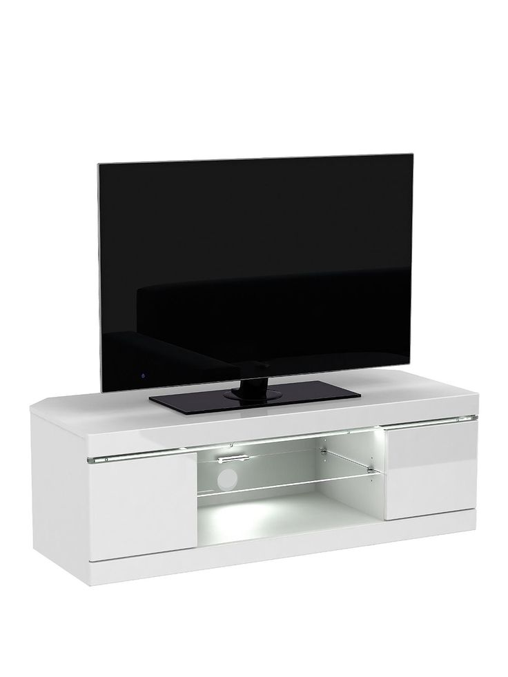 Innova Corner TV Unit in Black or White High Gloss with LED Lights - suitable for televisions up to 50 inch Optional home assembly service available* This striking corner TV unit from the Innova range is every bit as contemporary and sleek as the flat screen television you'll sit on it.A modern chunky design comes in choice of dramatic black or fresh white high gloss finishes, each of which flaunt a reflective, light-luring sheen.Speaking of light, it's given added wow by a warm white LED…