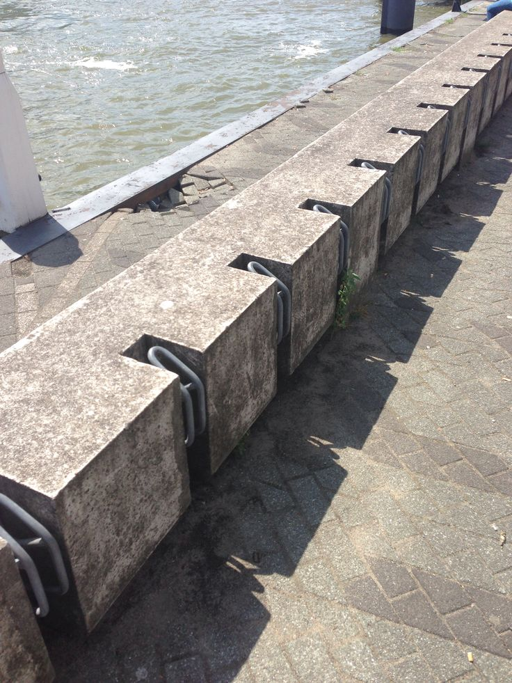 Bike + seat. Concrete and steel on the waterfront.