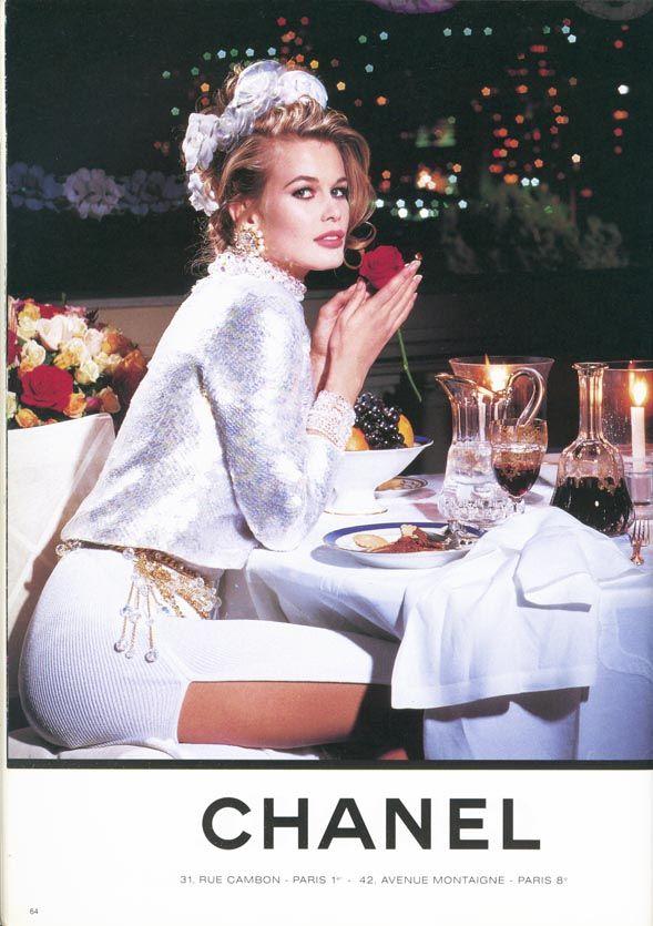 Claudia Schiffer in almost offensive all white like a faux diamond/rhinestone.