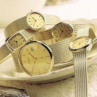 Gouden horloges met gouden band