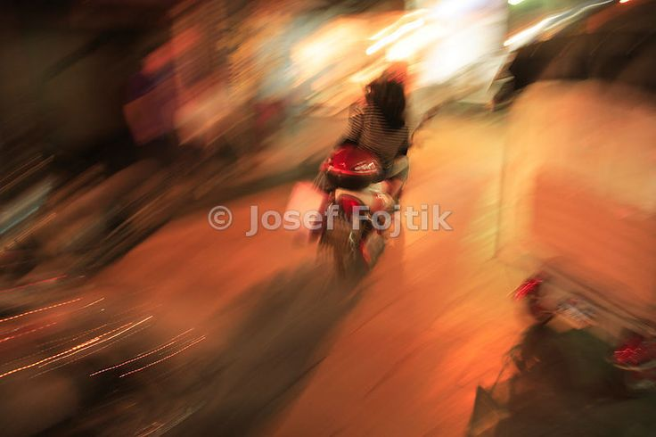 A motorcycle in the night Sian City, China