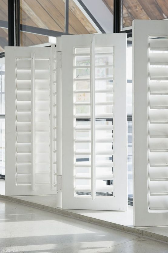 By-fold Shutters. Prefect for minimal obstruction of view when open. *LOVE*