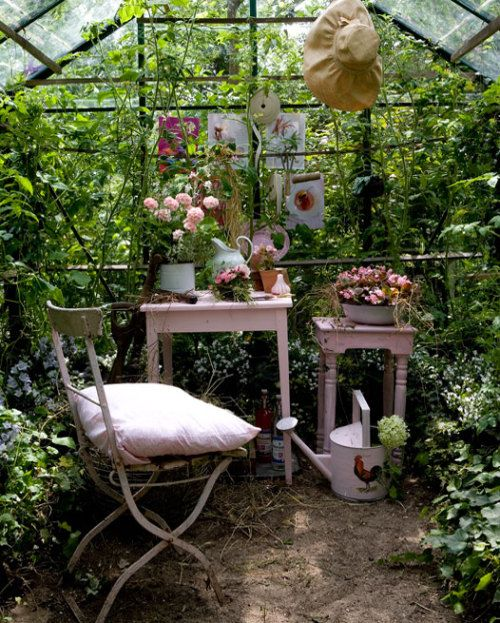 Greenhouse / sitting area / tons of greenery & flowers.
