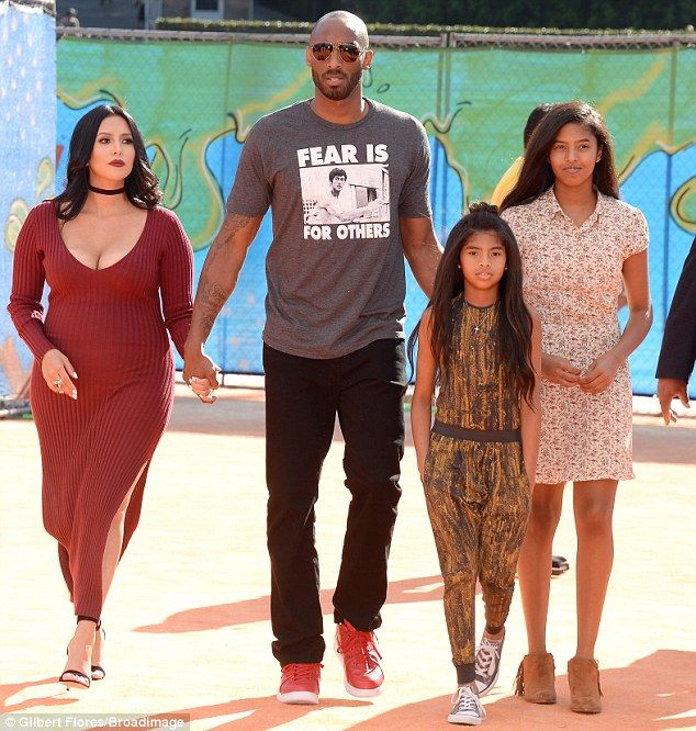 Holding hands: Kobe held hands with Vanessa as they escorted their daughters to the awards...