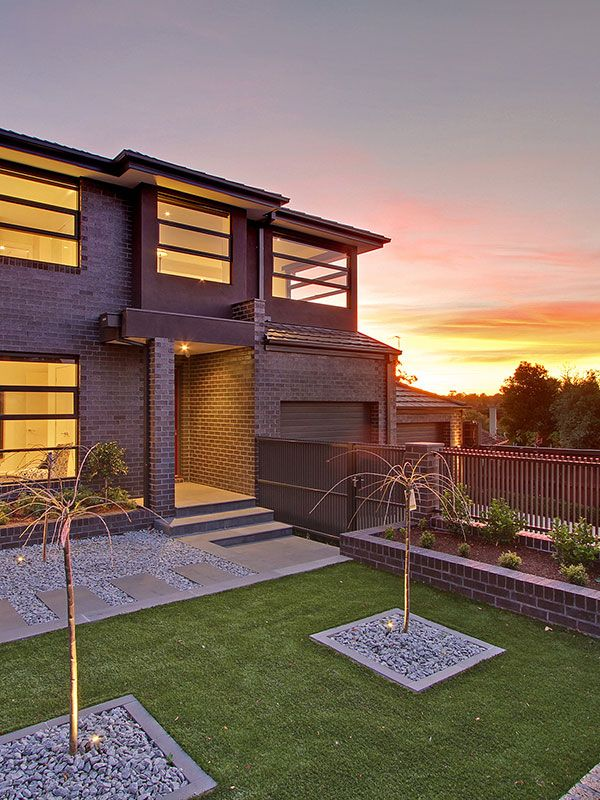 Making the most of this Sloping Block, this modern luxury custom built home is one to be admired.