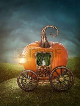 Fée: chariot de potiron sur la prairie Banque d