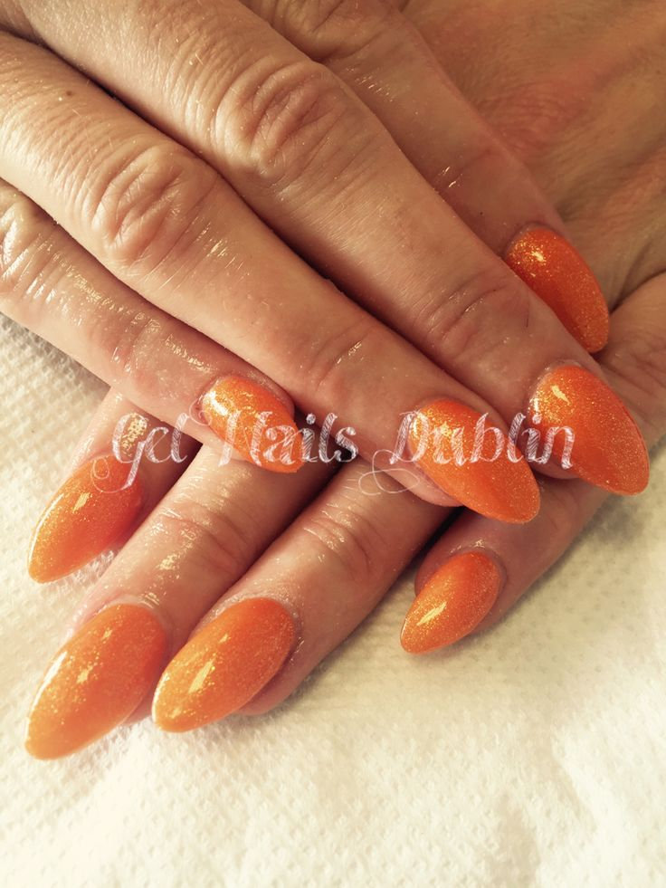 Full set of orange glitter nails for a happy hen party