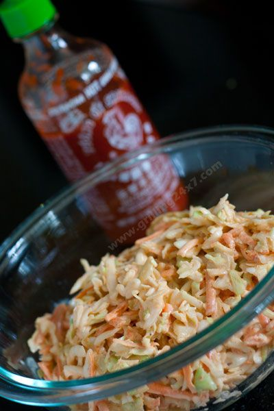A spicy #sriracha cole slaw recipe that is perfect for topping pulled pork tacos.