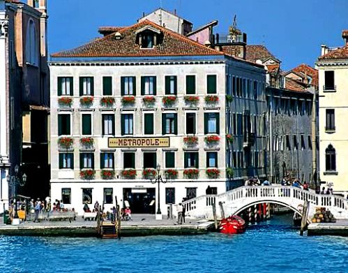 Across a little bridge, on the shores of a canal is a place you deserve to call home...even if only for a few days. Where is this? Click http://www.venice-italy-veneto.com/luxury-hotels-in-venice.html for the answer