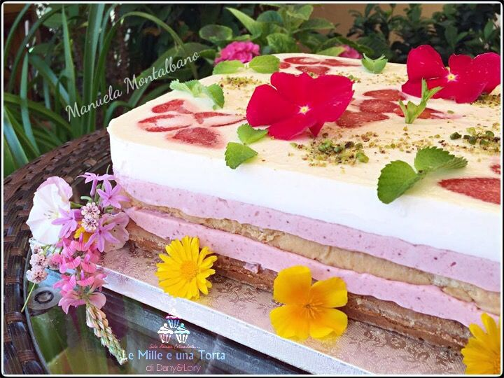 Condividi la ricetta...751TORTA GIARDINO DI FRAGOLE RIVISITATA DI LUCA MONTERSINO REALIZZATA DA: MANUELA MONTALBANO Dosi per uno stampo a cerniera quadrato di 25×25 cm Ingredienti: Pan di Spagna 6 uova 180 g di zucchero 90…
