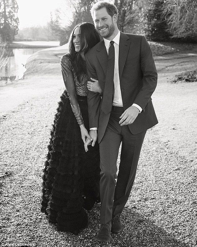 The couple delighted fans when they released a third photograph, pictured, as a thank you for the warm messages they had received in light of their engagement photos. The dress shows Meghan's elaborate gown in all its glory, with the tulle skirt lightly gliding along the ground