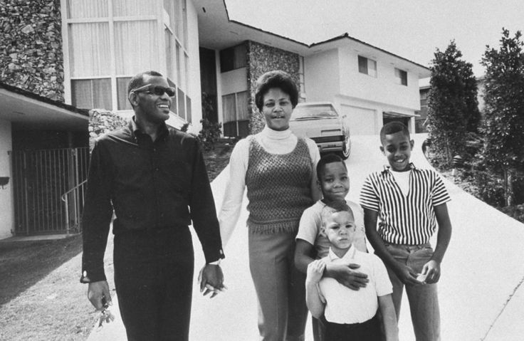 """Ray Charles stands in the driveway of his rambling Los Angeles home with his wife Della and sons Robert, 5, David, 7, and Ray Jr. 11. 'I don't need to see them to know what they look like,' he says. 'I know my wife is pretty, and I think my sons are pretty good boys.'"" NOTE: Ray and Della divorced in 1977; in all, Ray was married six times."