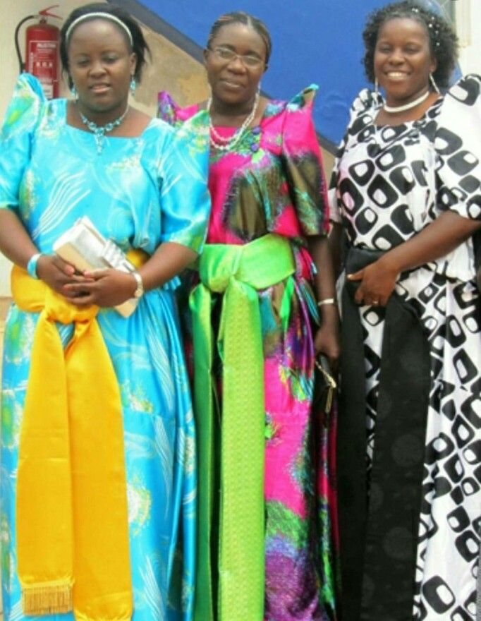 We are going to see how the women of Uganda style their present national attire called Gomesi. The Gomesi can be worn day to day and special functions. It is a floor-length, brightly colored cloth dress with puffed sleeves and a square neckline with two buttons on the left side of the neckline. The dress is tied with a sash placed below the waist over the hips.  #tasanni #tasannistas #fashion #fashionblogger #style #tradition #culture #Africatuesday #uganda #madeinafrica #dresses