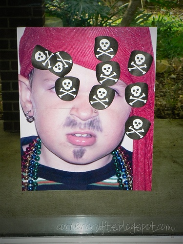 """Print a large photo of daughter dressed up as a pirate. Make patches with #Cricut and Life's a Party cartridge. Then play """"pin the patch on the pirate"""" at the birthday party! So fun and easy!"""