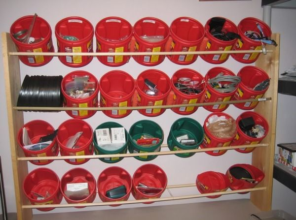 Coffee cans! My grandparent use to keep those and plastic Gatorade mix cans to put my grandpas loose tool bits for his job! But it is a step up from that! Whoever did this, smart and reusing them for another purpose