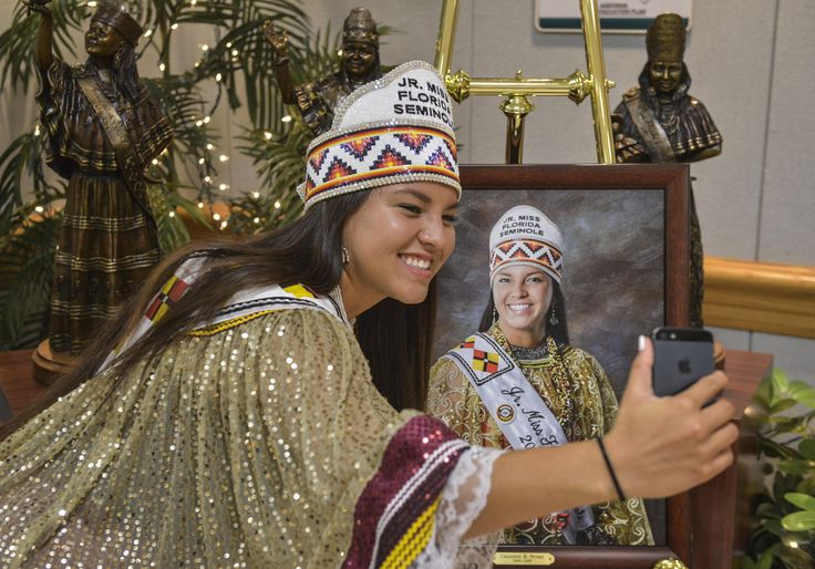 Outgoing Jr. Miss Florida Seminole Cheyenne Nunez snaps a selfie with her portrait at the Miss Florida Seminole pageant on July, 25, 2015 in Hollywood, Fla