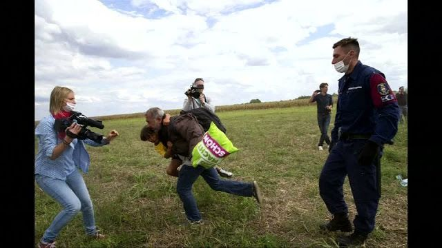 CHEIKWORLD.DAILY.PLANET: Hungary migrant trip camerawoman fired