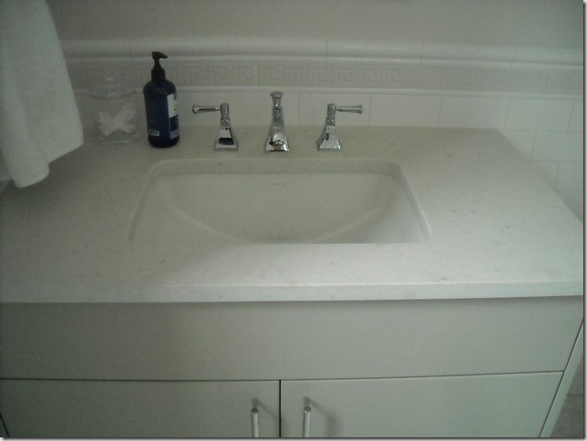 The vanity has misty carrera Caesarstone as the counter