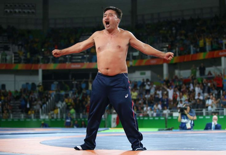 Unusual protest:    The coach of wrestler Mandakhnaran Ganzorig of Mongolia protests against the bronze medal result of the match with Ikhtiyor Navruzov of Uzbekistan by taking off his clothes on Aug. 21.