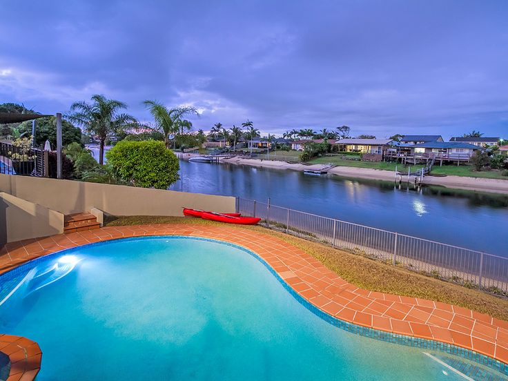 Enjoy the outdoors at Delungra holiday home (Gold Coast) with a huge pool, built in jacuzzi, grassed areas and kayaks.