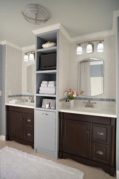 With a smaller dividing cabinet, but maybe some storage like this could go between the sinks