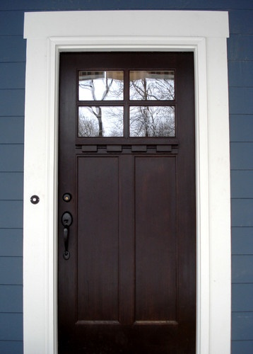 Deep stain on a Craftsman door next to vibrant blue is a nice combination.