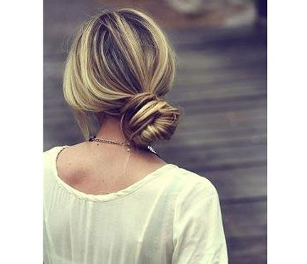 'Dos for a Rainy Day: The Low Side Bun. This style should be done in 20 seconds or less — anymore and it'll look fussy. The idea here is to keep the style relaxed while still appearing sophisticated. #SELFmagazine