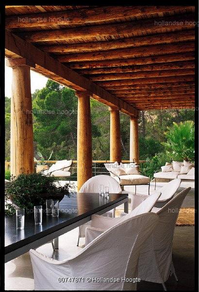 Wooden Veranda With Distinctive Wooden Pillars And Wooden