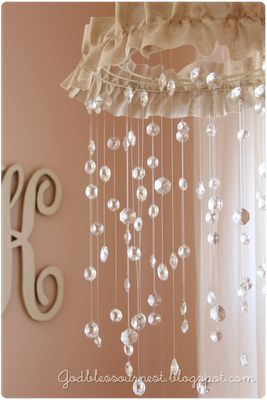 too cute! DIY Crystal Baby Mobile tutorial: spray painted Wire Wreath frame, Chandelier crystals, fishing line, fabric or other trim to hide wreath frame, sheet rock anchor w/ screw for hanging & lots of time!! @Sarah Chintomby Wilson @Meghan Krane Gillis