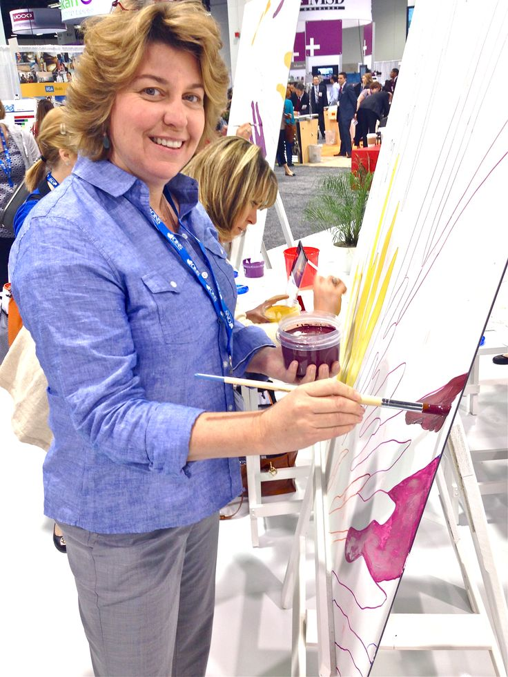 Painting a part of a canvas that will be a part of a larger art project commemorating art and cancer by Lilly Pharmaceuticals at the Oncology Nursing Society Conference in Anaheim, CA May 2014