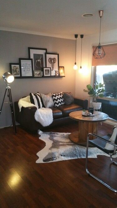 My family room with the new faux kmart cowhide