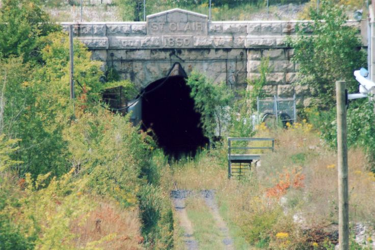 The original St. Clair tunnel, which links Port Huron, Michigan with Sarnia, Ontario, was the first railroad tunnel to pass beneath a river.  In its day it was the longest river tunnel in the world and the first cast iron tunnel of its kind.  During its years of operation, the tunnel claimed several lives, saw two failed terrorist attempts and even had one birth.  It has been closed to rail traffic since 1994 when a new tunnel was created.