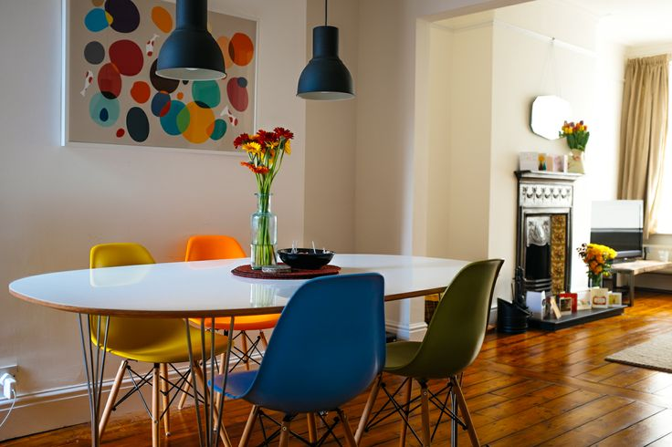 New dining room with IKEA HEKTAR lights, Ellipse table by Piet Hein and Eames DSW chairs.