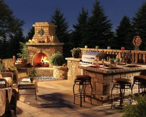 outdoor pergola with corner fireplace and kitchen ...
