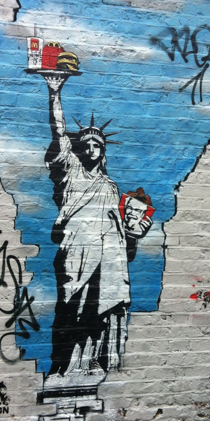 The statue of liberty eats KFC and McDonalds? Lol! No wonder she's green she must get sick from food a lot.