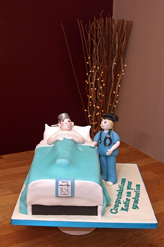 Hospital bed with patient & doctor cake