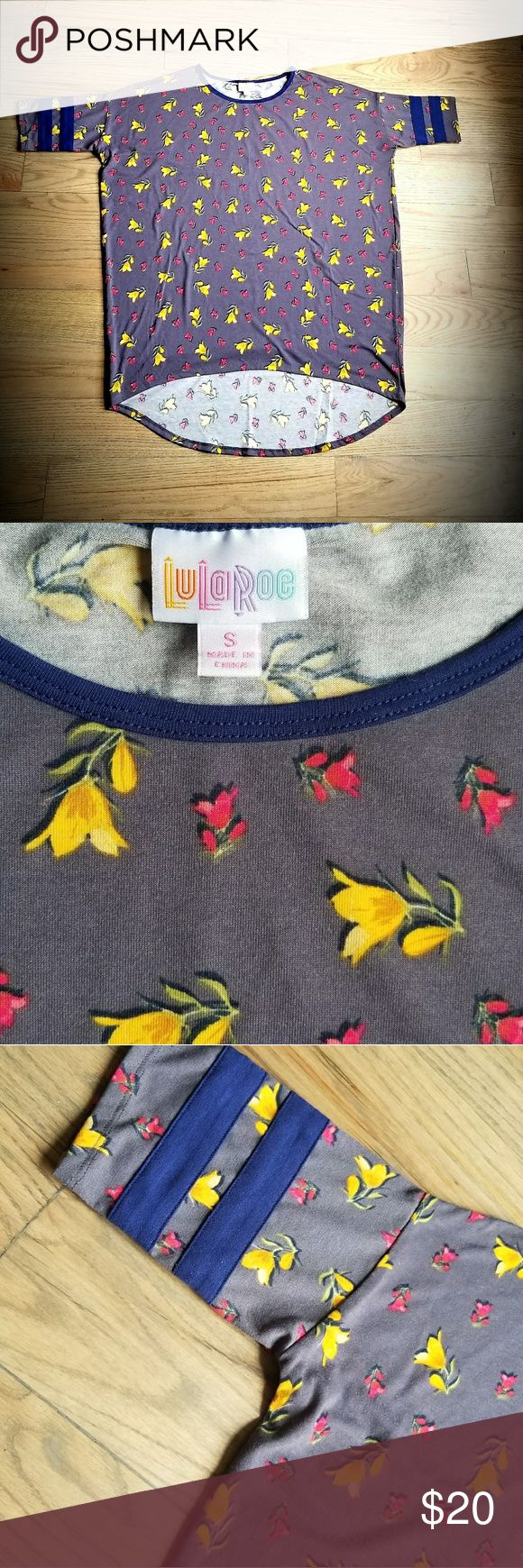 "Lularoe Irma Lularoe Irma is a loose knit hi/low ""tunic"" top. Perfect to wear with leggings. Grayish/blue background with yellow and pink flowers. Baseball sleeve, stripes are navy blue. Size small. These tops run big so size down a size. Smoke and pet free home. 96% polyester 4% spandex. Machine wash and hand to dry. LuLaRoe Tops"