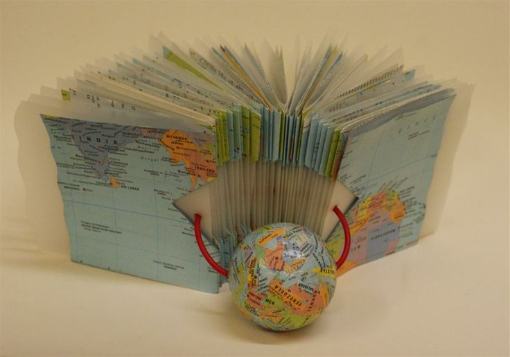 Atlas Book - Open by Inga Hunter. The shift in continents is expressed by the constantly shifting pages -they move around in all directions, but don't come apart.