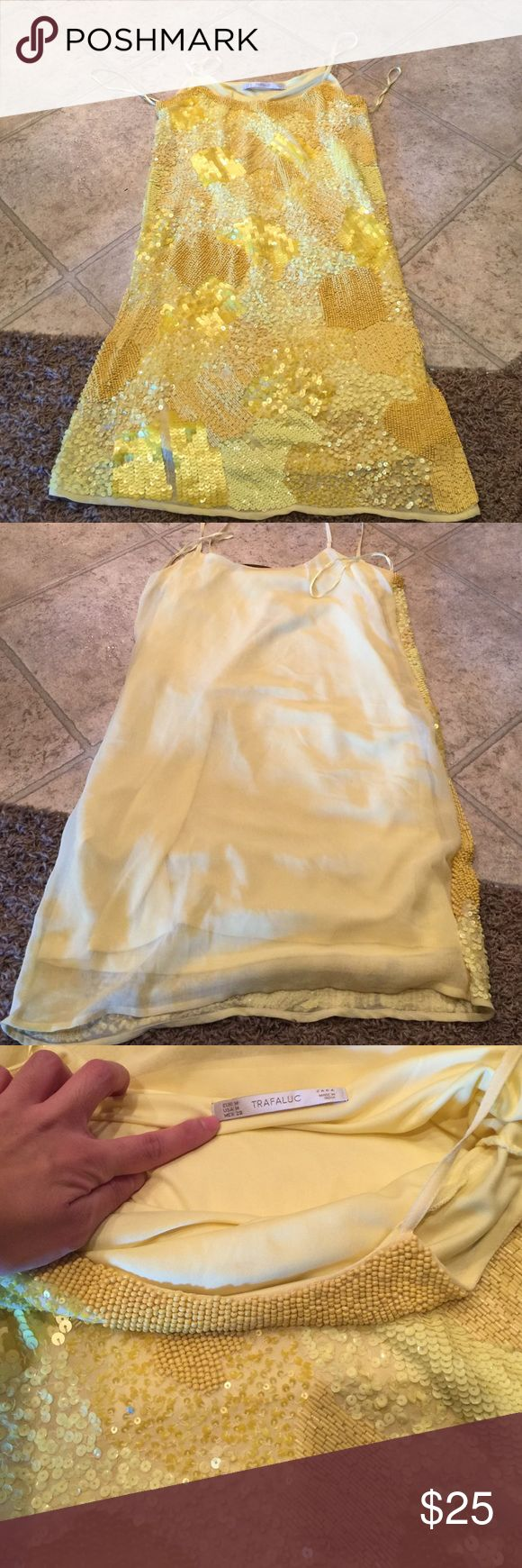 Zara trafaluc yellow sequin dress. So cute sold out . The dress is heavy and great quality . No zipper you slip on . Size medium or for a size small with a oversized look. I'm a size large in forever 21 and I can squeeze into it.... like new worn once . No stains or rips. Zara Dresses Mini