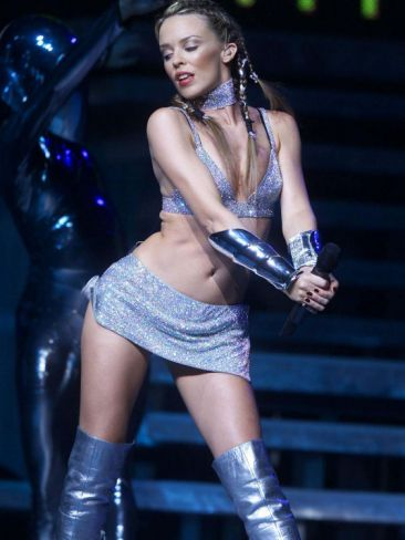 kylie minogue performing on stage kicking of her tour in uk