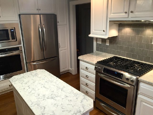 Kitchen aid appliances, Slate tiles and Quartz countertops on