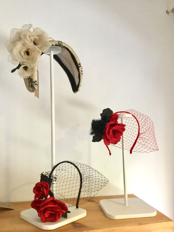 Halfhat and veils with silk roses.