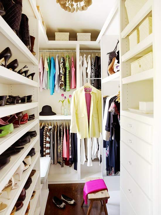 Even the narrowest of spaces can be outfitted with stellar storage, as this closet proves. Shelves, drawers, and bars line the walls to accommodate everything from jewelry to dresses. What the space lacks in square footage it makes up for in vertical space. The closet's main storage areas fall just short of the ceilings, and the space above is used for storing boxes of seasonal items.